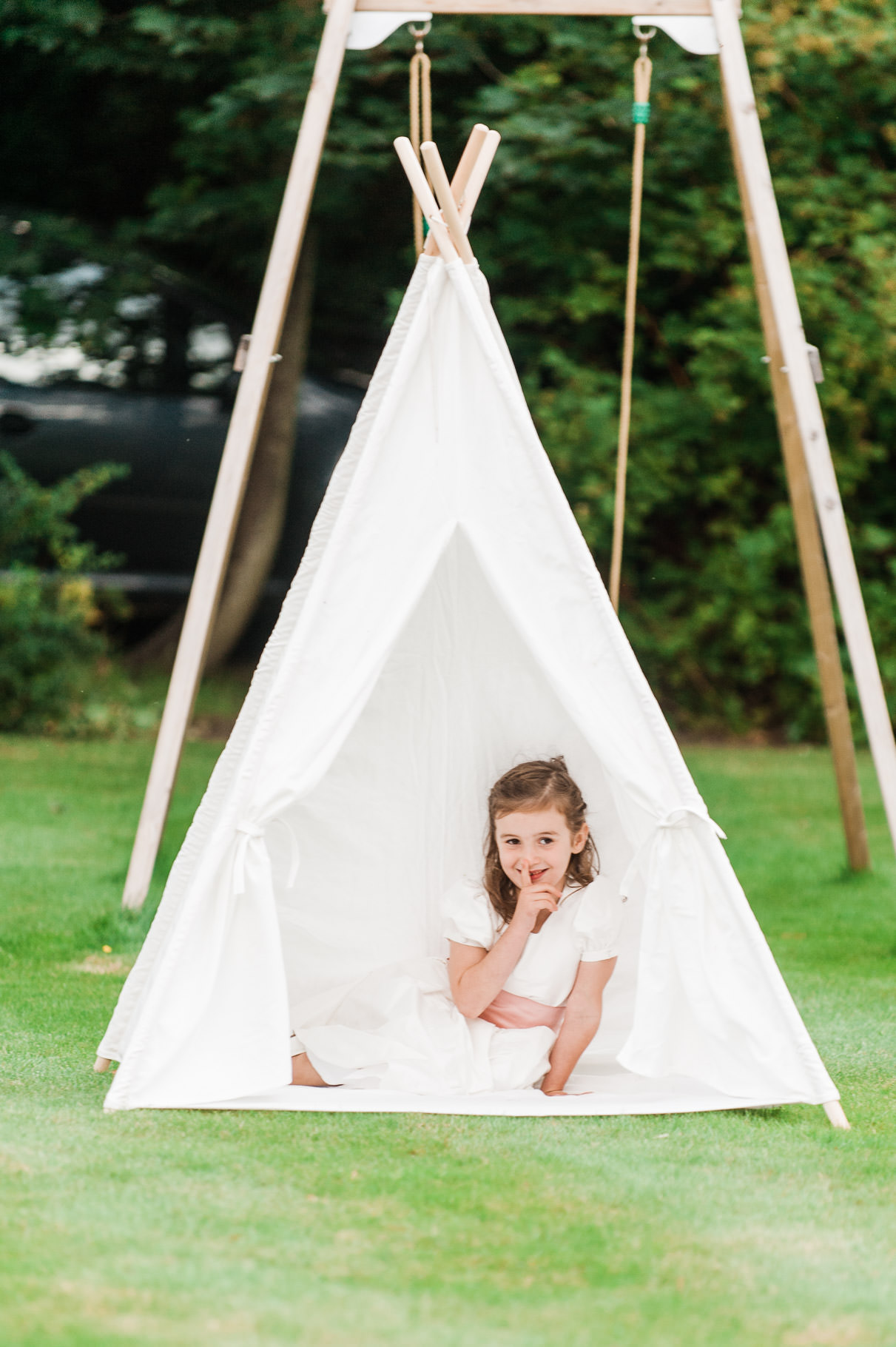 summer tipi wedding in scotland-child in tipi portrait-children's portrait-children at weddings