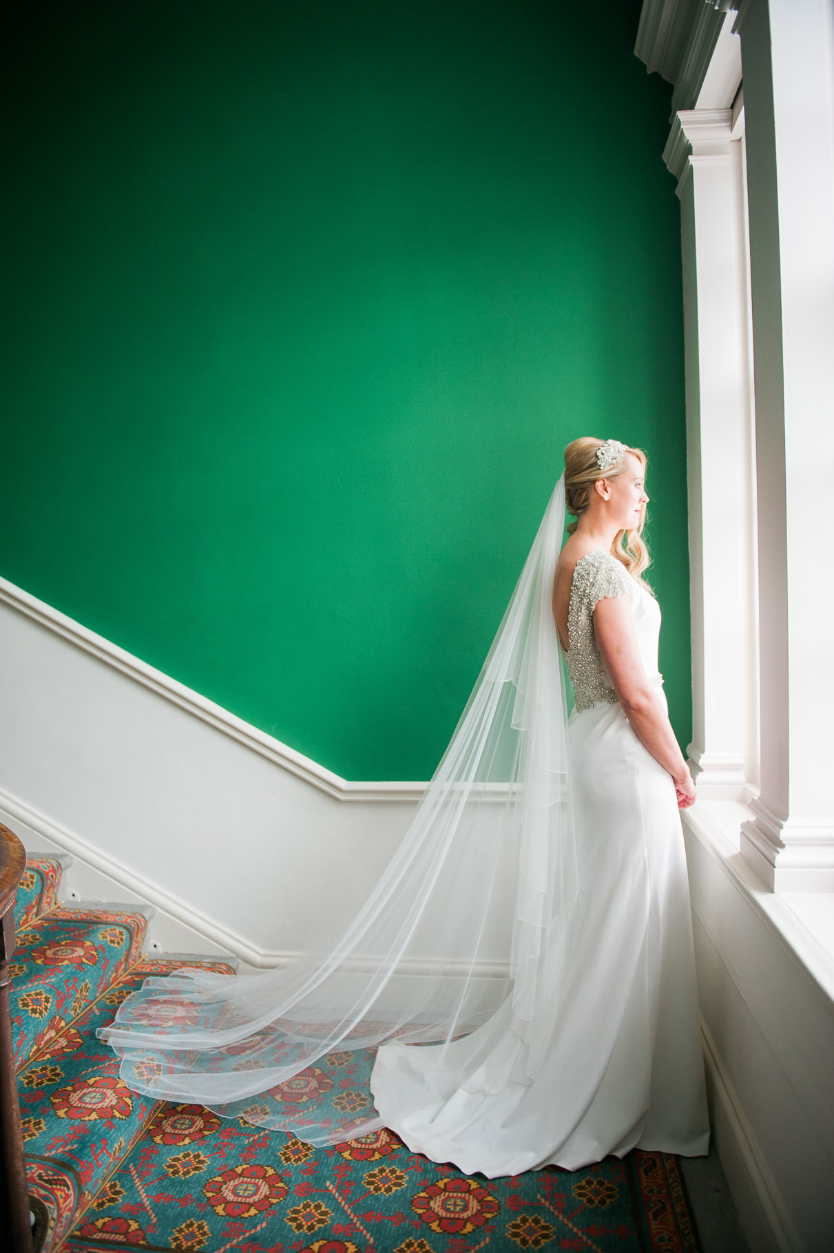 Bride at window of Dumfries House on Wedding Day