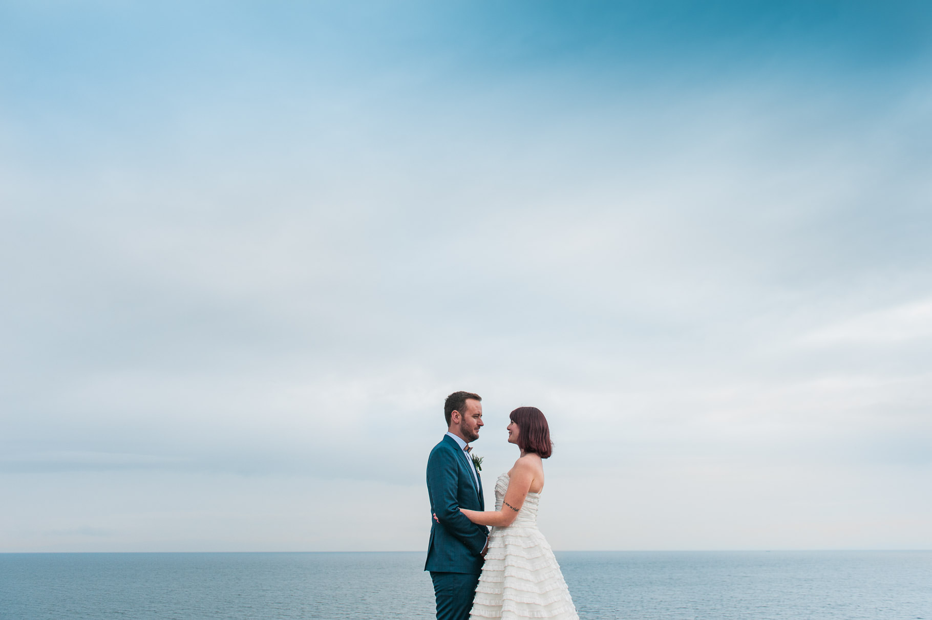 elopement by the sea-bride and groom portrait-bride and groom by the ocean