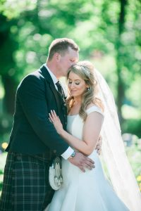 Summer Wedding in Scotland at House For An Art Lover-bride and groom embrace-backlit bride and groom
