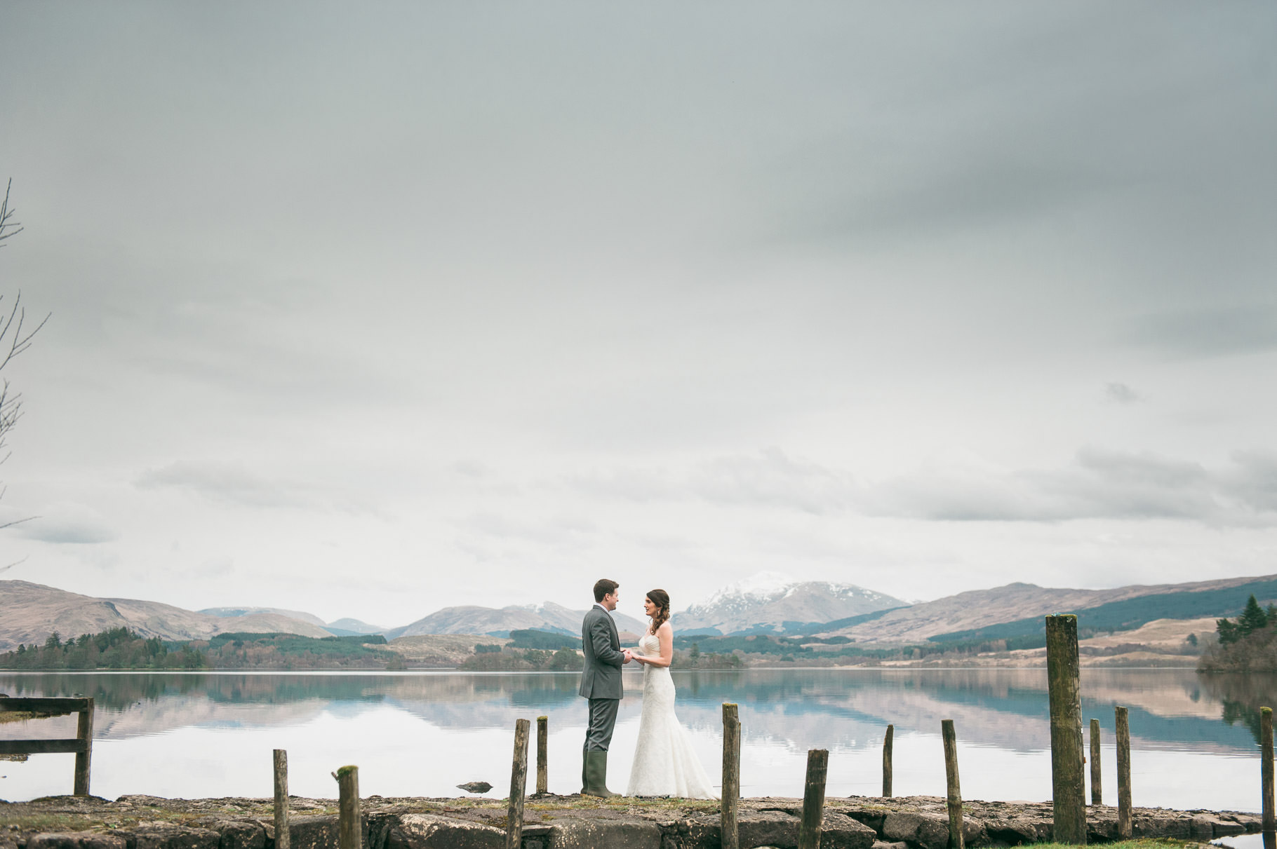 Scottish landscape at Loch Awe with bride and groom and mountains