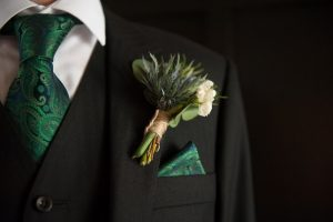 Groom's three piece wedding suit and green tie at House For An Art Lover Wedding