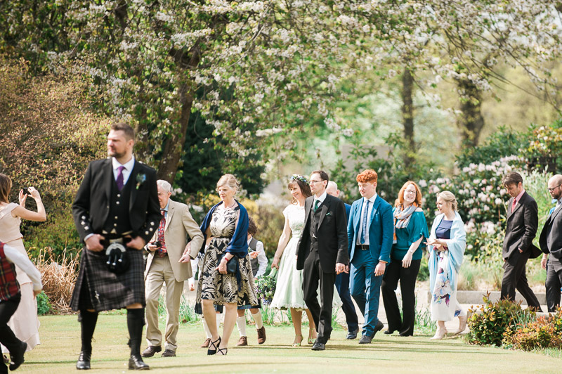 Wedding guests in Bellahouston park at House For An Art Lover Wedding