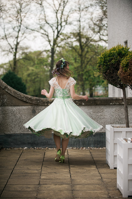 bride twirling in Green Wedding dress at House For An Art Lover Wedding