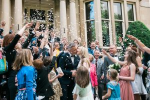 Wedding guests throwing confetti at bride and groom at Hotel du VIn Glasgow, One Devonshire Gardens