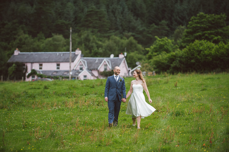 Bride and Groom walking to Loch Voil from Monachyle Mhor