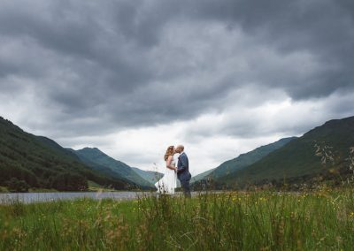 Monachyle Mhor Wedding ceremony outdoors, bride and groom at Loch beside Monachyle Mhor, Scottish wedding phtoogrpahy by brown's photogrpahy