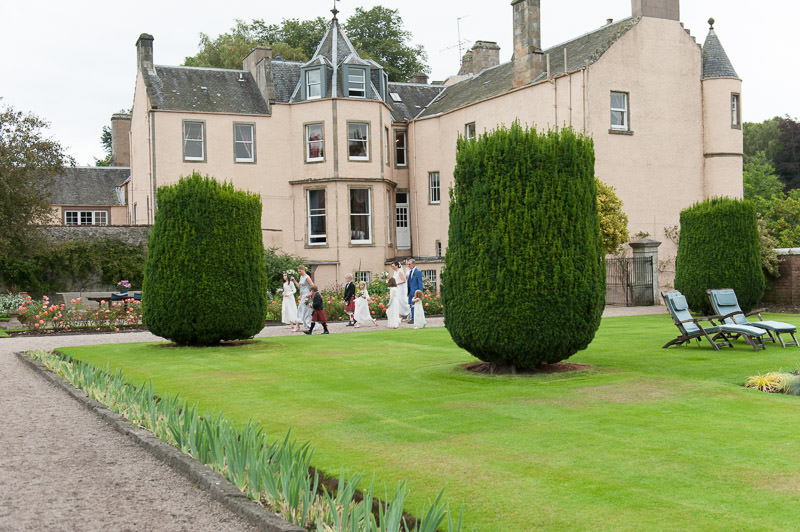 Bridal party in gardens of Myres Castle in Fife