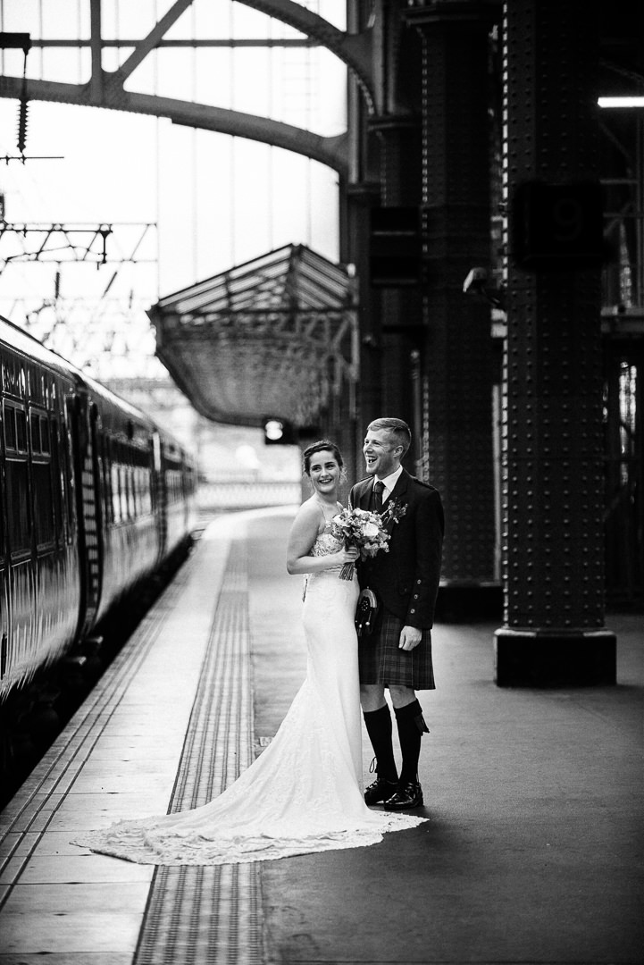 bride and groom in Glasgow central station, glasgow central station wedding photograph, black and white photo of glasgow central station