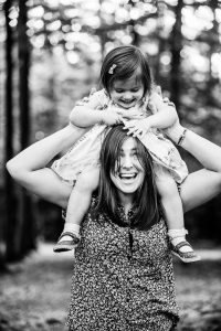 mother and daughter, fun photograph of mum and daughter, child on mum's shoulders