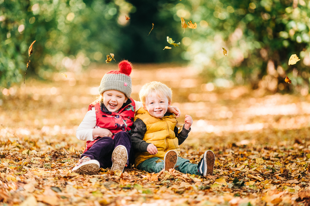 children playing in autumn leaves, glasgow pollok park in autumn, family portrait in glasgow, children in autumn,