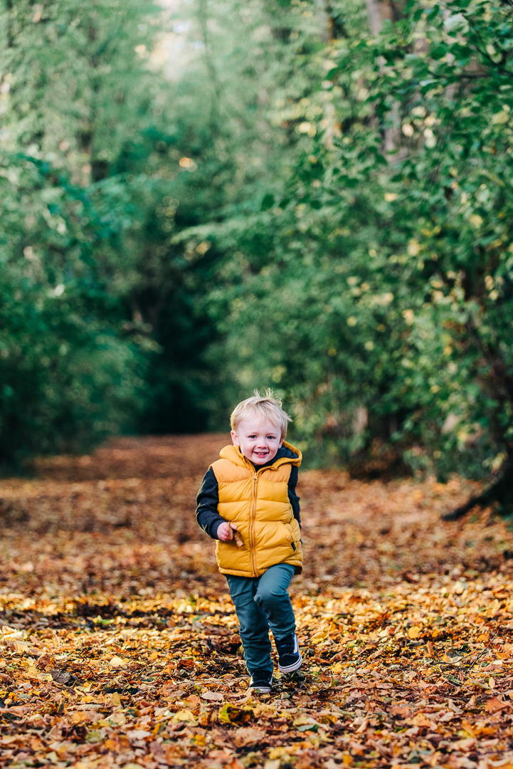 children playing in autumn leaves, glasgow pollok park in autumn, family portrait in glasgow, boy running in autumn leaves,