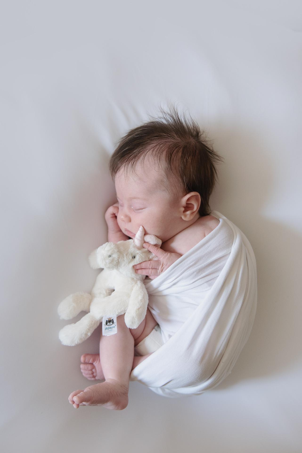 Newborn baby and toy